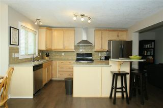 Photo 9: 76 SUNSET Heights: Cochrane Detached for sale : MLS®# C4226992