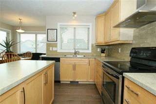 Photo 11: 76 SUNSET Heights: Cochrane Detached for sale : MLS®# C4226992