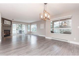 "Photo 6: 203 20217 MICHAUD Crescent in Langley: Langley City Condo for sale in ""Michaud Gardens"" : MLS®# R2442178"
