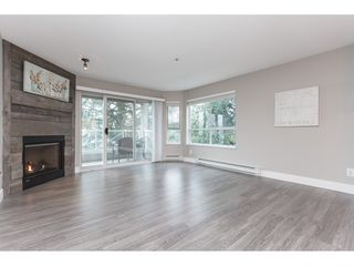 "Photo 2: 203 20217 MICHAUD Crescent in Langley: Langley City Condo for sale in ""Michaud Gardens"" : MLS®# R2442178"