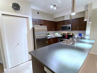 Main Photo: 2203 604 EAST LAKE Boulevard NE: Airdrie Apartment for sale : MLS®# C4291389