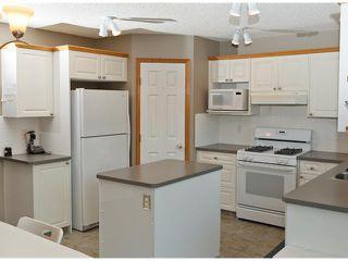 Photo 7: 16 ROCKY RIDGE Close NW in CALGARY: Rocky Ridge Ranch Residential Detached Single Family for sale (Calgary)  : MLS®# C3505840