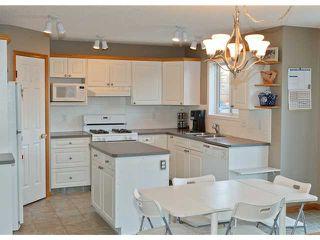 Photo 6: 16 ROCKY RIDGE Close NW in CALGARY: Rocky Ridge Ranch Residential Detached Single Family for sale (Calgary)  : MLS®# C3505840