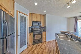 Photo 4: 37 COVEBROOK Place NE in Calgary: Coventry Hills Detached  : MLS®# C3651101
