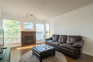 Photo 1: 410 33738 KING Road in Abbotsford: Poplar Condo for sale : MLS®# R2171658