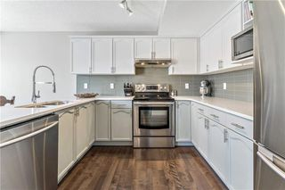 Photo 7: 21 COVENTRY Garden NE in Calgary: Coventry Hills Detached for sale : MLS®# C4196542
