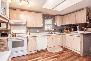 Photo 4: 313 Stanley Avenue: Okotoks Detached for sale : MLS®# C4224963