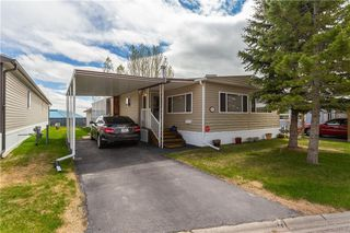 Photo 2: 15 99 Arbour Lake Road NW in Calgary: Arbour Lake Mobile for sale : MLS®# C4297540