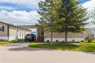 Photo 3: 15 99 Arbour Lake Road NW in Calgary: Arbour Lake Mobile for sale : MLS®# C4297540