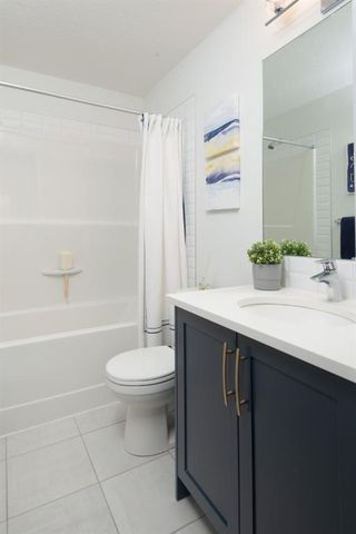 Photo 16: 104 15 Evanscrest Park NW in Calgary: Evanston Row/Townhouse for sale : MLS®# A1054519