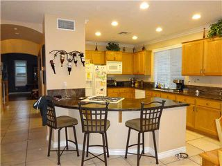 Photo 2: RANCHO SAN DIEGO House for sale : 5 bedrooms : 1738 Sunset Rose Court in El Cajon