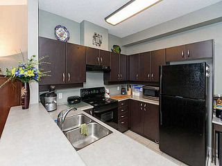 "Photo 4: 130 10838 CITY Parkway in Surrey: Whalley Condo for sale in ""THE ACCESS"" (North Surrey)  : MLS®# F1408654"