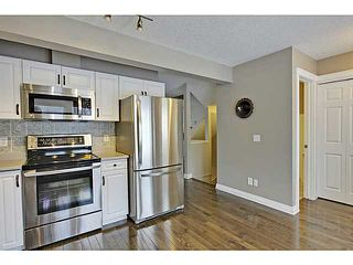 Photo 8: 262 REGAL Park NE in Calgary: Renfrew_Regal Terrace Townhouse for sale : MLS®# C3650275