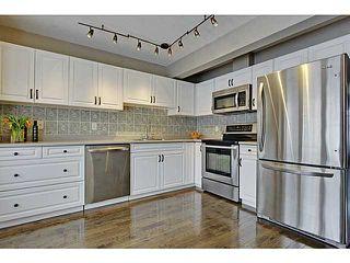 Photo 5: 262 REGAL Park NE in Calgary: Renfrew_Regal Terrace Townhouse for sale : MLS®# C3650275