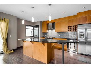 Photo 1: 3 1625 34 Avenue SW in Calgary: Altadore_River Park Townhouse for sale : MLS®# C3651020