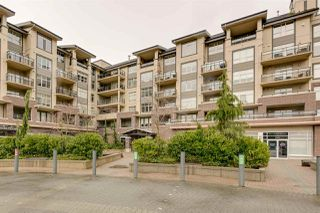 "Photo 1: 220 1211 VILLAGE GREEN Way in Squamish: Downtown SQ Condo for sale in ""Rockcliffe"" : MLS®# R2043365"