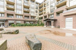 "Photo 2: 220 1211 VILLAGE GREEN Way in Squamish: Downtown SQ Condo for sale in ""Rockcliffe"" : MLS®# R2043365"