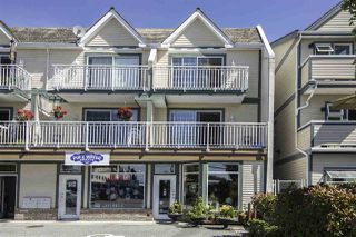 "Photo 1: 220 3571 CHATHAM Street in Richmond: Steveston Village Townhouse for sale in ""STEVESTON VILLAGE"" : MLS®# R2114524"