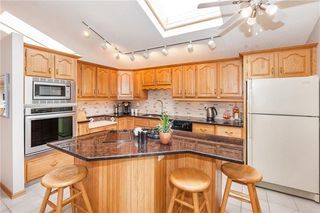 Photo 5: 111 RANCH ESTATES Place NW in Calgary: Ranchlands House for sale : MLS®# C4167276