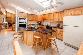 Photo 8: 111 RANCH ESTATES Place NW in Calgary: Ranchlands House for sale : MLS®# C4167276