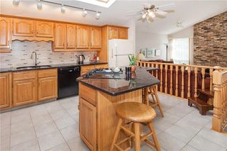 Photo 4: 111 RANCH ESTATES Place NW in Calgary: Ranchlands House for sale : MLS®# C4167276