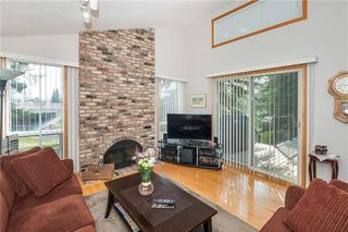 Photo 12: 111 RANCH ESTATES Place NW in Calgary: Ranchlands House for sale : MLS®# C4167276