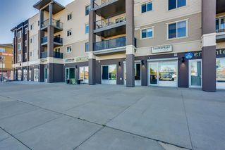 Photo 2: 6207 403 MACKENZIE Way SW: Airdrie Apartment for sale : MLS®# A1037130