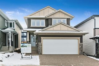 Photo 1: 294 Crestmont Drive SW in Calgary: Crestmont Detached for sale : MLS®# A1055191