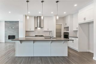 Photo 4: 294 Crestmont Drive SW in Calgary: Crestmont Detached for sale : MLS®# A1055191
