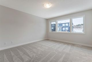 Photo 15: 294 Crestmont Drive SW in Calgary: Crestmont Detached for sale : MLS®# A1055191