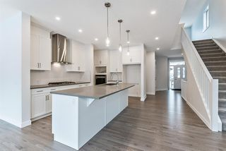 Photo 5: 294 Crestmont Drive SW in Calgary: Crestmont Detached for sale : MLS®# A1055191