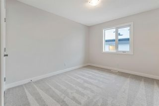 Photo 21: 294 Crestmont Drive SW in Calgary: Crestmont Detached for sale : MLS®# A1055191