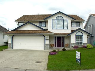 "Photo 1: 35453 LETHBRIDGE Drive in Abbotsford: Abbotsford East House for sale in ""Sandy Hill"" : MLS®# F1110467"