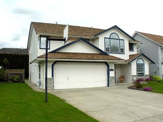 "Photo 3: 35453 LETHBRIDGE Drive in Abbotsford: Abbotsford East House for sale in ""Sandy Hill"" : MLS®# F1110467"