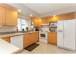 """Photo 9: 16 21746 52 Avenue in Langley: Murrayville Townhouse for sale in """"Glenwood Village Estates"""" : MLS®# R2087086"""