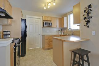 Photo 10: 802 8000 Wentworth Drive SW in The Axxis: Townhouse for sale : MLS®# C3643528