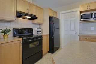 Photo 13: 802 8000 Wentworth Drive SW in The Axxis: Townhouse for sale : MLS®# C3643528