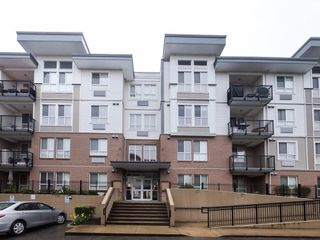 "Photo 1: 221 5430 201 Street in Langley: Langley City Condo for sale in ""The Sonnet"" : MLS®# R2257402"