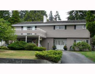Photo 1: 909 THERMAL Drive in Coquitlam: Home for sale : MLS®# V772774