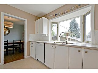 Photo 10: 6304 LACOMBE Way SW in Calgary: Lakeview House for sale : MLS®# C4020490