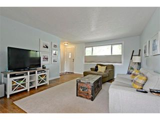 Photo 7: 6304 LACOMBE Way SW in Calgary: Lakeview House for sale : MLS®# C4020490