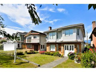 Photo 1: 3167 E 3RD Avenue in Vancouver: Renfrew VE House for sale (Vancouver East)  : MLS®# V1134930