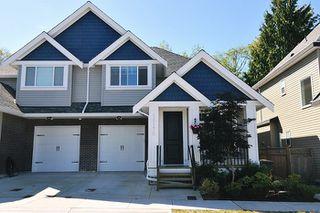 Photo 1: 18170 70 Avenue in Surrey: Cloverdale BC House 1/2 Duplex for sale (Cloverdale)  : MLS®# R2103288