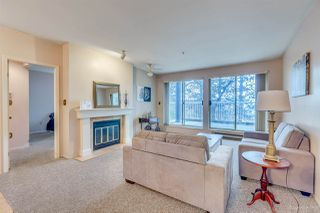 "Photo 1: 101 2733 ATLIN Place in Coquitlam: Coquitlam East Condo for sale in ""ATLIN COURT"" : MLS®# R2154213"
