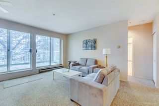 "Photo 3: 101 2733 ATLIN Place in Coquitlam: Coquitlam East Condo for sale in ""ATLIN COURT"" : MLS®# R2154213"