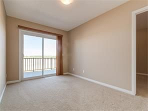 Photo 3: 4052 Windsong Boulevard SW in Airdrie: windsong House for sale : MLS®# C4120616
