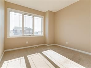 Photo 2: 4052 Windsong Boulevard SW in Airdrie: windsong House for sale : MLS®# C4120616