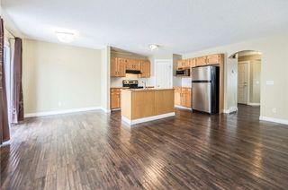 Photo 11: 23 TUSCARORA Way NW in Calgary: Tuscany House for sale : MLS®# C4174470