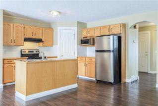 Photo 6: 23 TUSCARORA Way NW in Calgary: Tuscany House for sale : MLS®# C4174470