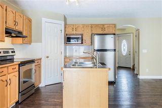 Photo 7: 23 TUSCARORA Way NW in Calgary: Tuscany House for sale : MLS®# C4174470